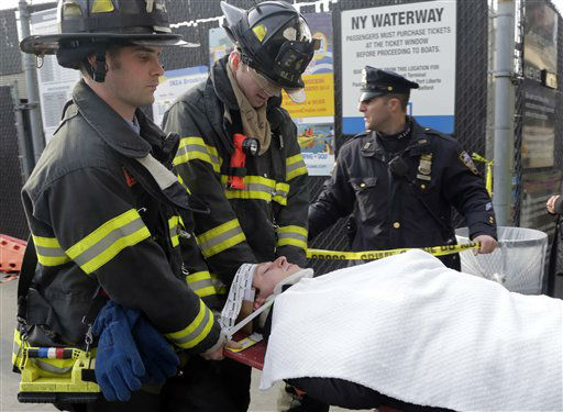 "<div class=""meta ""><span class=""caption-text "">An injured passenger from the Seastreak Wall Street is taken to an ambulance, in New York,  Wednesday, Jan. 9, 2013. The Seastreak Wall Street ferry from Atlantic Highlands, N.J., banged into the mooring as it arrived at South Street in lower Manhattan during morning rush hour, injuring as many as 50 people, at least one critically, officials said.(AP Photo/Richard Drew) (AP Photo/ Richard Drew)</span></div>"