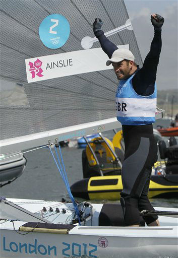 Ben Ainslie of Great Britain celebrates his gold medal during the Finn dinghy class medal race at the London 2012 Summer Olympics, Sunday, Aug. 5, 2012, in Weymouth and Portland, England. &#40;AP Photo&#47;Francois Mori&#41; <span class=meta>(AP Photo&#47; Francois Mori)</span>