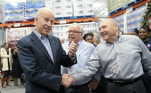 Vice President Joe Biden shakes hands with Costco CEO Craig Jelinek, right, as co-founder Jim Sinegal watches at center, after Biden arrived to shop at the new Costco store in Washington, Thursday, Nov. 29, 2012. Biden went shopping for presents and to highlight the importance of renewing middle-class tax cuts so families and businesses have more certainty at this critical time for our economy. &#40;AP Photo&#47;Susan Walsh&#41; <span class=meta>(AP Photo&#47; Susan Walsh)</span>