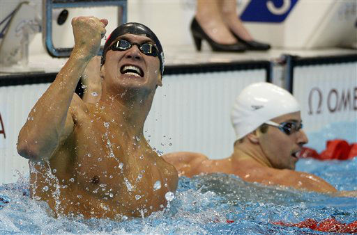 United States&#39; Nathan Adrian, left, celebrates winning ahead of Australia&#39;s James Magnussen in the men&#39;s 100-meter freestyle swimming final at the Aquatics Centre in the Olympic Park during the 2012 Summer Olympics in London, Wednesday, Aug. 1, 2012. &#40;AP Photo&#47;Mark J. Terrill&#41; <span class=meta>(AP Photo&#47; Mark J. Terrill)</span>