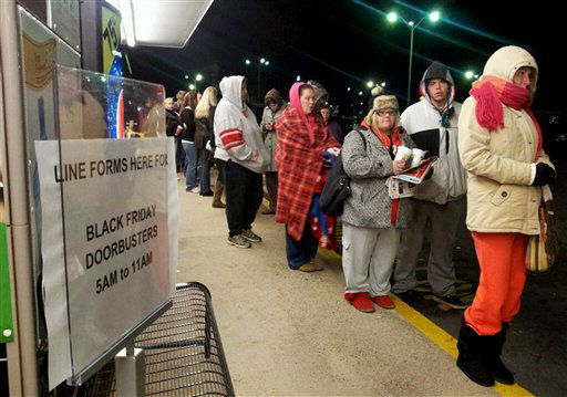 Shoppers wait outside November 23, 2012, for doors to open for Black Friday deals at 5 a.m. at Kmart in Chambersburg, Pa.