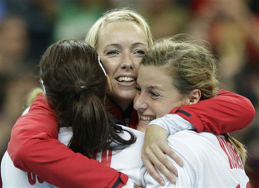 Players of Norway celebrate after winning the women&#39;s handball gold medal match against Montenegro at the 2012 Summer Olympics, Saturday, Aug. 11, 2012, in London. &#40;AP Photo&#47;Matthias Schrader&#41; <span class=meta>(AP Photo&#47; Matthias Schrader)</span>