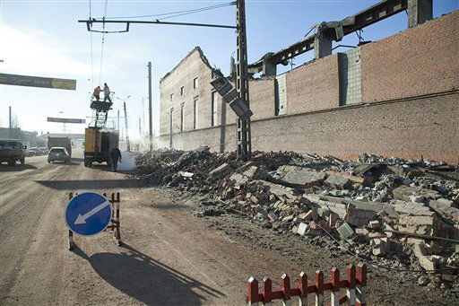In this photo provided by Chelyabinsk.ru municipal workers repair damaged electric power circuit outside a zinc factory building with about 600 square meters &#40;6000 square feet&#41; of a roof collapsed  after a meteorite exploded over in Chelyabinsk region on Friday, Feb. 15, 2013 A meteor streaked across the sky of Russia?s Ural Mountains on Friday morning, causing sharp explosions and reportedly injuring around 100 people, including many hurt by broken glass. &#40;AP Photo&#47; Oleg Kargapolov, Chelyabinsk.ru&#41; <span class=meta>(AP Photo&#47; Oleg Kargapolov)</span>