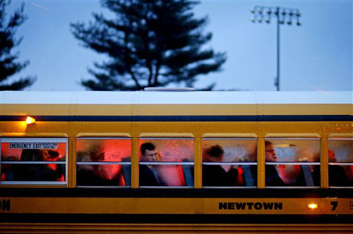 People arrive on a school bus at Newtown High School for a memorial vigil attended by President Barack Obama for the victims of the Sandy Hook Elementary School shooting, Sunday, Dec. 16, 2012, in Newtown, Conn. A gunman walked into Sandy Hook Elementary School in Newtown Friday and opened fire, killing 26 people, including 20 children. &#40;AP Photo&#47;David Goldman&#41; <span class=meta>(AP Photo&#47; David Goldman)</span>