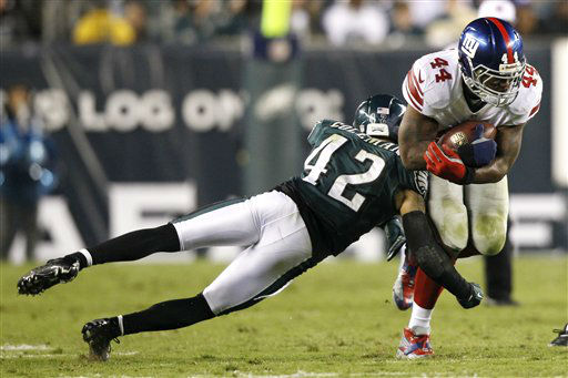 New York Giants running back Ahmad Bradshaw &#40;44&#41; runs with the ball as Philadelphia Eagles strong safety Kurt Coleman &#40;42&#41; goes for the tackle during the second half of an NFL football game Sunday, Sept. 30, 2012, in Philadelphia. &#40;AP Photo&#47;Mel Evans&#41; <span class=meta>(AP Photo&#47; Mel Evans)</span>