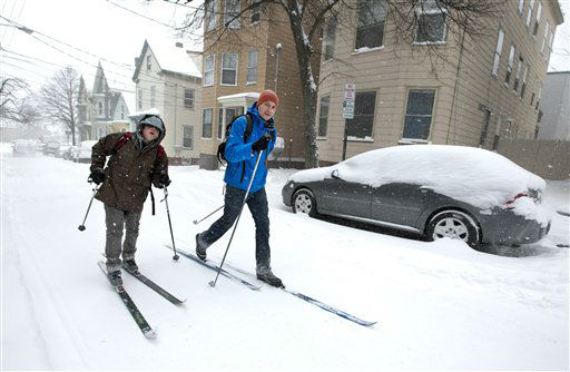 Andre Tranchemantague, left, and Will Guerette, ski on a snow-covered road as they make there way to a bar during the early stages of a snow storm, Friday, Feb. 8, 2013, in Portland, Maine.  A snowstorm sweeping into Maine already has dumped half-a-foot of snow around Portland and contributed to a 19-car pileup. And it&#39;s just getting started. Chris Legrow from the National Weather Service says a blizzard warning is issued Friday evening for the southern coast, when the main storm arrives. The forecast calls for up to 2 feet of snow and winds gusting to 50 mph. &#40;AP Photo&#47;Robert F. Bukaty&#41; <span class=meta>(Photo&#47;Robert F. Bukaty)</span>