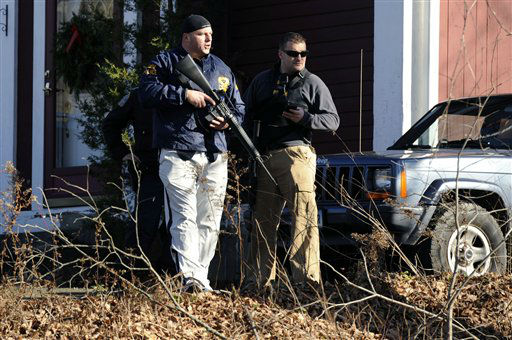 Law enforcement canvass an area following a shooting at the Sandy Hook Elementary School in Newtown, Conn., about 60 miles &#40;96 kilometers&#41; northeast of New York City, Friday, Dec. 14, 2012. An official with knowledge of Friday&#39;s shooting said 27 people were dead, including 18 children.  &#40;AP Photo&#47;Jessica Hill&#41; <span class=meta>(AP Photo&#47; Jessica Hill)</span>