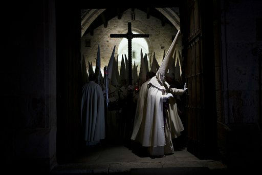 Penitents of the Jesus Yacente brotherhood take part in a Holy Week procession in Zamora, northern Spain, Thursday, March 28, 2013. Hundreds of processions take place throughout Spain during the Easter Holy Week. &#40;AP Photo&#47;Daniel Ochoa de Olza&#41; <span class=meta>(AP Photo&#47; Daniel Ochoa de Olza)</span>