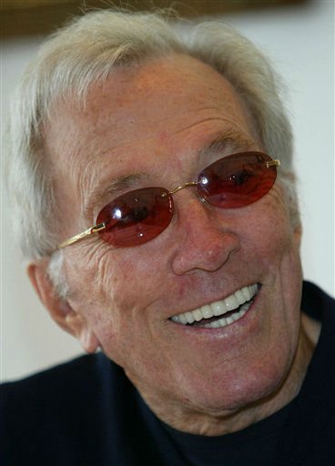 FILE - In this July 25, 2004 file photo, U.S. singer Andy Williams smiles as he speaks to reporters during his news conference at a Tokyo hotel. Emmy-winning TV host and &#34;Moon River&#34; crooner Williams died Tuesday night, Sept, 25, 2012 at his home in Branson, Mo., following a year-long battle with bladder cancer. He was 84. &#40;AP Photo&#47;Shizuo Kambayashi, File&#41; <span class=meta>(AP Photo&#47; SHIZUO KAMBAYASHI)</span>