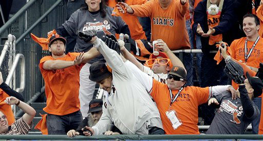Fans try and catch a home run hit by San Francisco Giants&#39; Pablo Sandoval during the first inning of Game 1 of baseball&#39;s World Series against the Detroit Tigers Wednesday, Oct. 24, 2012, in San Francisco. &#40;AP Photo&#47;David J. Phillip&#41; <span class=meta>(AP Photo&#47; David J. Phillip)</span>