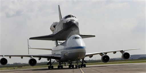 "<div class=""meta image-caption""><div class=""origin-logo origin-image ""><span></span></div><span class=""caption-text"">Space shuttle Endeavour sits atop the shuttle aircraft carrier as it taxis Wednesday, Sept. 19, 2012, at Ellington Field in Houston. Endeavour is making a final trek across the country to the California Science Center in Los Angeles, where it will be permanently displayed. (AP Photo/David J. Phillip) (AP Photo/ David J. Phillip)</span></div>"