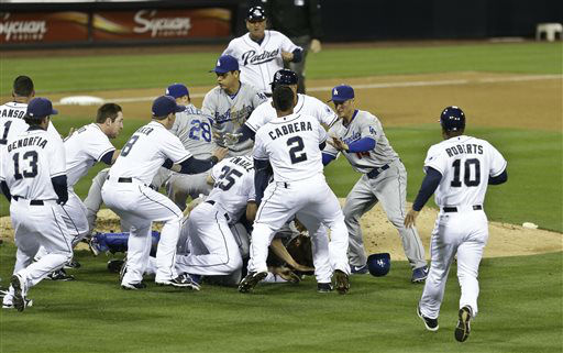 San Diego Padres&#39; Carlos Quentin and teammates battle the Los Angeles Dodgers after Quentin was hit by a pitch thrown by Dodgers pitcher Zack Greinke in the sixth inning of baseball game in San Diego, Thursday, April 11, 2013. &#40;AP Photo&#47;Lenny Ignelzi&#41; <span class=meta>(AP Photo&#47; Lenny Ignelzi)</span>