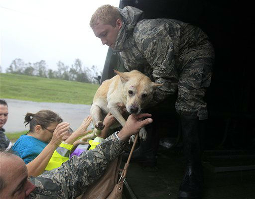 People and a dog who were rescued from their flooded homes are loaded into a Louisiana National Guard truck, after Hurricane Isaac made landfall and flooded homes with 10 feet of water in Braithwaite, La., in Plaquemines Parish Wednesday, Aug. 29, 2012. &#40;AP Photo&#47;Gerald Herbert&#41; <span class=meta>(AP Photo&#47; Gerald Herbert)</span>