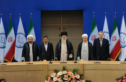 In this photo released by the official website of the Iranian supreme leader&#39;s office, supreme leader Ayatollah Ali Khamenei, center, parliament speaker Ali Larijani, right, chief of Expediency Council, Akbar Hashemi Rafsanjani, second right, President Mahmoud Ahmadinejad, second left, and judiciary chief Sadeq Larijani, left, listen to Iran&#39;s national anthem, at the opening session of the Nonaligned Movement, NAM, summit, in Tehran, Iran, Thursday, Aug. 30, 2012. &#40;AP Photo&#47;Office of the Supreme Leader&#41; <span class=meta>(AP Photo&#47; Uncredited)</span>