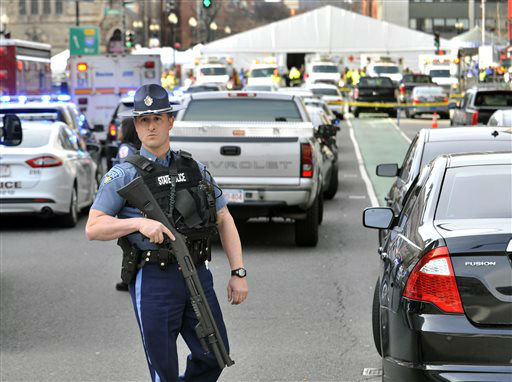"<div class=""meta image-caption""><div class=""origin-logo origin-image ""><span></span></div><span class=""caption-text"">A Massachusetts state police officer guards the area containing the medical tent, rear, following an explosion at the 2013 Boston Marathon in Boston, Monday, April 15, 2013. Two explosions shattered the euphoria of the Boston Marathon finish line on Monday, sending authorities out on the course to carry off the injured while the stragglers were rerouted away from the smoking site of the blasts. (AP Photo/Josh Reynolds) (AP Photo/ Josh Reynolds)</span></div>"