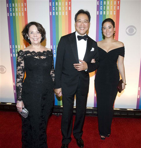 Former Kennedy Center Honoree Yo-Yo Ma, his wife, Jill Horner, left, and daughter, Emily Ma, arrive at the Kennedy Center for the Performing Arts for the 2012 Kennedy Center Honors Performance and Gala Sunday, Dec. 2, 2012 at the State Department in Washington. &#40;AP Photo&#47;Kevin Wolf&#41; <span class=meta>(AP Photo&#47; Kevin Wolf)</span>