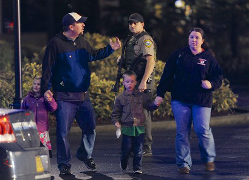 "<div class=""meta ""><span class=""caption-text "">A family leaves the scene of a multiple shooting at Clackamas Town Center Mall in Clackamas, Ore., Tuesday Dec. 11, 2012. A gunman is dead after opening fire in the Portland, Ore., area shopping mall Tuesday, killing two people and wounding another, sheriff's deputies said. (AP Photo/Greg Wahl-Stephens) (AP Photo/ Greg Wahl-Stephens)</span></div>"