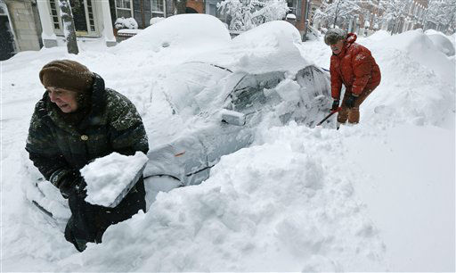 Deb Hanley, left, and Frank McGuire dig about three feet of snow from around their car outside their home in the Beacon Hill neighborhood of Boston, Saturday, Feb. 9, 2013. The Boston area received about two feet of snow from a winter storm. A howling storm across the Northeast left the New York-to-Boston corridor shrouded in 1 to 3 feet of snow Saturday, stranding motorists on highways overnight and piling up drifts so high that some homeowners couldn&#39;t get their doors open. More than 650,000 homes and businesses were left without electricity. &#40;AP Photo&#47;Charles Krupa&#41; <span class=meta>(AP Photo&#47; Charles Krupa)</span>