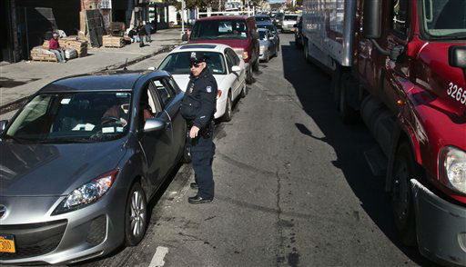 Police direct cars to gas pumps outside a gas station on Friday, Nov. 9, 2012 in Brooklyn, N.Y.  Police were at gas stations to enforce a new gasoline rationing plan that lets motorists fill up every other day that started in New York on Friday morning. &#40;AP Photo&#47;Bebeto Matthews&#41; <span class=meta>(AP Photo&#47; Bebeto Matthews)</span>