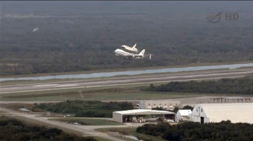 "<div class=""meta ""><span class=""caption-text "">This framegrab image provided by NASA TV shows space shuttle Endeavour atop NASA's Shuttle Carrier Aircraft, or SCA, at the Shuttle Landing Facility in the early morning hours at NASA's Kennedy Space Center on Wednesday, Sept. 19, 2012 in Cape Canaveral, Fla. The SCA, a modified 747 jetliner, will fly Endeavour to Los Angeles where it will be placed on public display at the California Science Center. This is the final ferry flight scheduled in the Space Shuttle Program era. (AP Photo/NASA-TV) (AP Photo/ Uncredited)</span></div>"