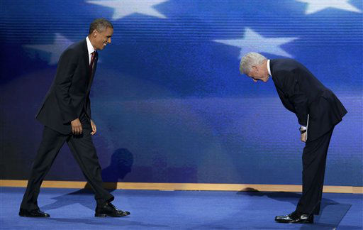 Former President Bill Clinton bows as President Barack Obama walks on stage after Clinton&#39;s address to the Democratic National Convention in Charlotte, N.C., on Wednesday, Sept. 5, 2012. &#40;AP Photo&#47;J. Scott Applewhite&#41; <span class=meta>(AP Photo&#47; J. Scott Applewhite)</span>
