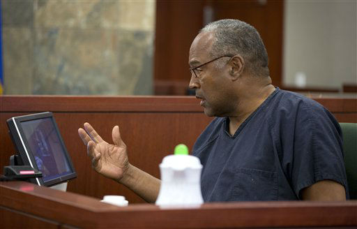 O.J. Simpson comments on video evidence as he testifies during an evidentiary hearing in Clark County District Court, Wednesday, May 15, 2013 in Las Vegas. Simpson, who is currently serving a nine to 33-year sentence in state prison as a result of his October 2008 conviction for armed robbery and kidnapping charges, is using a writ of habeas corpus to seek a new trial, claiming he had such bad representation that his conviction should be reversed. &#40;AP Photo&#47;Julie Jacobson, Pool&#41; <span class=meta>(AP Photo&#47; Julie Jacobson)</span>