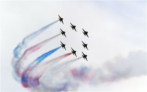 South Korean Air Force&#39;s aerobatic team, the Black Eagles, performs during the 64th anniversary of Armed Forces Day at the Gyeryong military headquarters in Gyeryong, south of Seoul, South Korea, Wednesday, Sept. 26, 2012. South Korea will celebrate its 64th Armed Forces Day on Oct. 1. &#40;AP Photo&#47;Lee Jin-man&#41; <span class=meta>(AP Photo&#47; Lee Jin-man)</span>