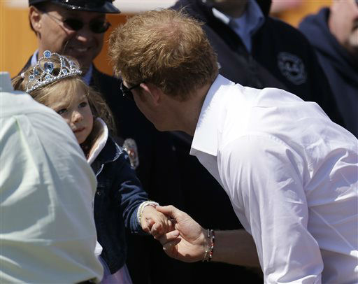 Britain&#39;s Prince Harry, right, talks to a young girl at Casino Pier during a tour of the area hit by Superstorm Sandy, Tuesday, May 14, 2013, in Seaside Heights, N.J. The prince toured the community&#39;s rebuilt boardwalk, which is about two-thirds complete. New Jersey sustained about &#36;37 billion worth of damage from the storm. &#40;AP Photo&#47;Julio Cortez&#41; <span class=meta>(AP Photo&#47; Julio Cortez)</span>