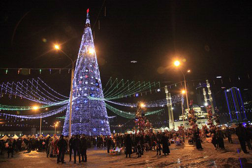 People gather at a New Year tree, in front of a mosque, in a square decorated for New Year celebrations in Chechnya&#39;s provincial capital Grozny, southern Russia, Saturday, Dec. 29, 2012. &#40;AP Photo&#47;Musa Sadulayev&#41; <span class=meta>(AP Photo&#47; Musa Sadulayev)</span>