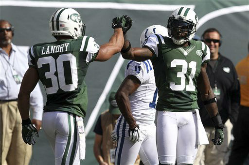 New York Jets free safety LaRon Landry &#40;30&#41; and teammate Antonio Cromartie &#40;31&#41; celebrate after a play during the first half of an NFL football game against the Indianapolis Colts Sunday, Oct. 14, 2012 in East Rutherford, N.J. &#40;AP Photo&#47;Seth Wenig&#41; <span class=meta>(AP Photo&#47; Seth Wenig)</span>