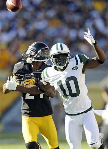 Pittsburgh Steelers cornerback Ike Taylor &#40;24&#41; and New York Jets wide receiver Santonio Holmes &#40;10&#41; tangle as a pass goes by in the second quarter of an NFL football game, Sunday, Sept. 16, 2012, in Pittsburgh. &#40;AP Photo&#47;Don Wright&#41; <span class=meta>(AP Photo&#47; Don Wright)</span>