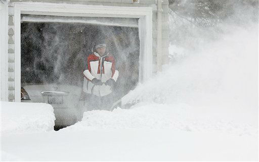 "<div class=""meta ""><span class=""caption-text "">Mark Gasbarro starts to snow blow his driveway after two feet of snow fell during the blizzard Saturday, Feb. 9, 2013, in Providence, R.I. A howling storm across the Northeast left the New York-to-Boston corridor shrouded in 1 to 3 feet of snow Saturday, stranding motorists on highways overnight and piling up drifts so high that some homeowners couldn't get their doors open. More than 650,000 homes and businesses were left without electricity.  (AP Photo/Stew Milne) (AP Photo/ Stew Milne)</span></div>"