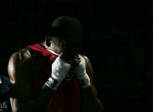 Jamel Herring, of the United States reacts after being defeated by Kazakhstan&#39;s Daniyar Yelessinov in their men&#39;s light welter 64-kg boxing match at the 2012 Summer Olympics, Tuesday, July 31, 2012, in London. &#40;AP Photo&#47;Ivan Sekretarev&#41; <span class=meta>(AP Photo&#47; Ivan Sekretarev)</span>