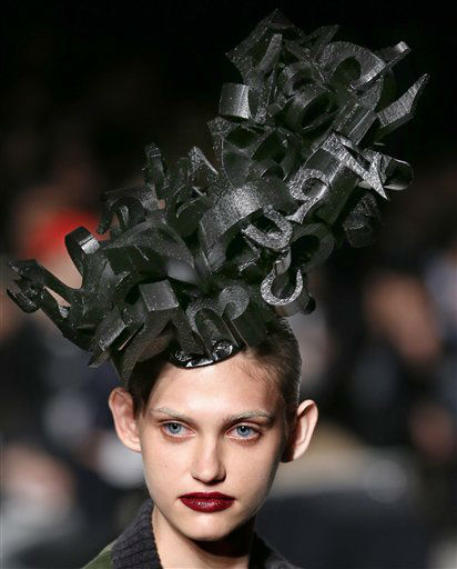 A model displays creations from MACARONIC's 2013-2014 Autumn/Winter collection designed by Japan's Takashi Aoki at Tokyo Fashion Week in Tokyo, Wednesday, March 20, 2013. More than 40 brands participated in the week-long event. (AP Photo/Shizuo Kambayashi)