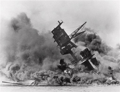 The battleship USS Arizona belches smoke as it topples over into the sea during a Japanese surprise attack on Pearl Harbor, Hawaii, in a  Dec. 7, 1941 file photo. The ship sank with more than 80  percent of its 1,500-man crew, including Rear Admiral Isaac C. Kidd . The attack, which left 2,343 Americans dead and 916 missing, broke the backbone of the U.S. Pacific Fleet and forced America out of a policy of isolationism.   &#40;AP Photo&#47;File&#41; <span class=meta>(AP Photo&#47; Anonymous)</span>