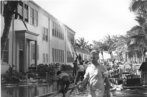 Rescue workers help evacuate the Lunalilo High School in Honolulu after the roof of the main building was hit by a bomb during the Japanese attack at Pearl Harbor, Hawaii in this Dec. 7, 1941 file photo.
