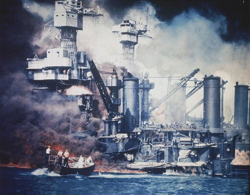 In this Dec. 7, 1941 file photo, a  small boat rescues a USS West Virginia crew member from the water after the Japanese bombing of Pearl Harbor, Hawaii.  <span class=meta>(AP Photo&#47; Anonymous)</span>