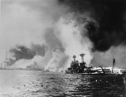 "<div class=""meta ""><span class=""caption-text "">This Dec. 7, 1941 file photo provided by the Dept. of Defense shows the USS California, right, after being struck by two battleships and two big bombs during a Japanese sneak attack on Pearl Harbor.  (Photo/Anonymous)</span></div>"