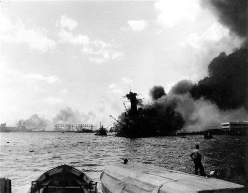 The battleship USS California is afire and listing to port in the Japanese aerial attack on Pearl Harbor, Hawaii, on Dec. 7, 1941.  &#40;AP Photo&#41; <span class=meta>(Photo&#47;Anonymous)</span>