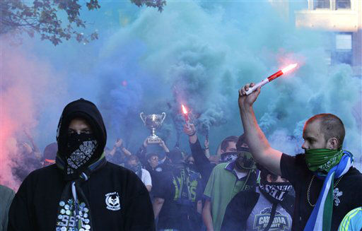 Seattle Sounders supporters march with flares and smoke bombs to the stadium prior to an MLS soccer match against the Portland Timbers, Sunday, Oct. 7, 2012, in Seattle. &#40;AP Photo&#47;Ted S. Warren&#41; <span class=meta>(AP Photo&#47; Ted S. Warren)</span>