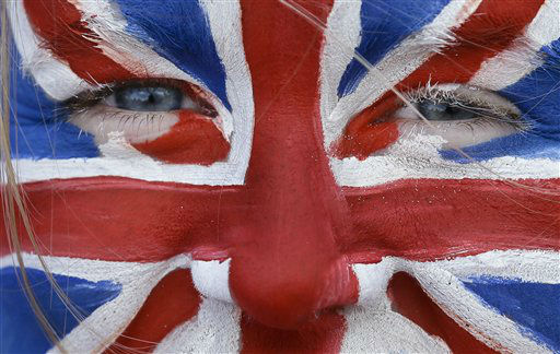 Emily Parsons, 11, from Nottingham, England, wears face paint in the colors of the British flag as she watches the games on a large outdoor television screen in Olympic Park at the 2012 Summer Olympics, Thursday, Aug. 2, 2012, in London. &#40;AP Photo&#47;Ben Curtis&#41; <span class=meta>(AP Photo&#47; Ben Curtis)</span>