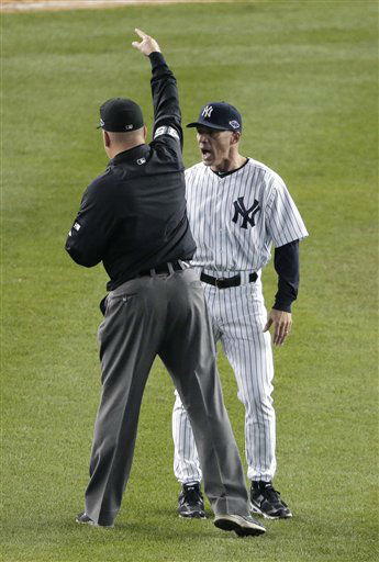 New York Yankees&#39; Joe Girardi is ejected by umpire Jeff Nelson in the eighth inning of  Game 2 of the American League championship series Sunday, Oct. 14, 2012, in New York. &#40;AP Photo&#47;Charlie Riedel&#41; <span class=meta>(AP Photo&#47; Charlie Riedel)</span>