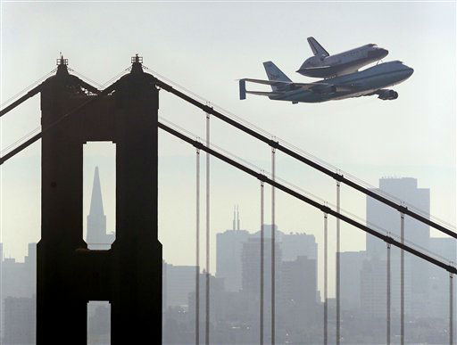 "<div class=""meta ""><span class=""caption-text "">Space Shuttle Endeavour mounted on NASA's Shuttle Carrier Aircraft, passes over the Golden Gate Bridge in San Francisco, Friday, Sept. 21, 2012. Endeavour is making a final trek across the country to the California Science Center in Los Angeles, where it will be permanently displayed. (AP Photo/Marcio Jose Sanchez)</span></div>"