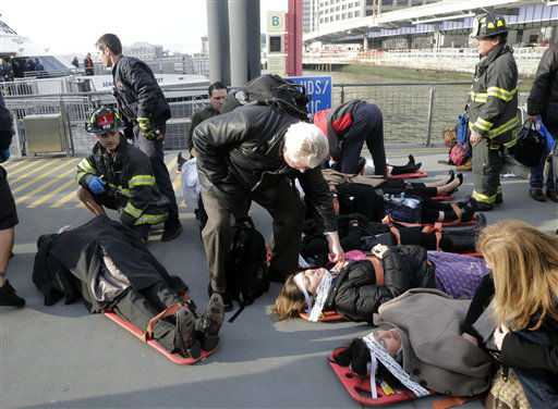 Injured passengers of the Seastreak Wall Street ferry are aided, in New York,  Wednesday, Jan. 9, 2013. The ferry from Atlantic Highlands, N.J., banged into the mooring as it arrived at South Street in lower Manhattan during morning rush hour, injuring as many as 50 people, at least one critically, officials said.&#40;AP Photo&#47;Richard Drew&#41; <span class=meta>(AP Photo&#47; Richard Drew)</span>