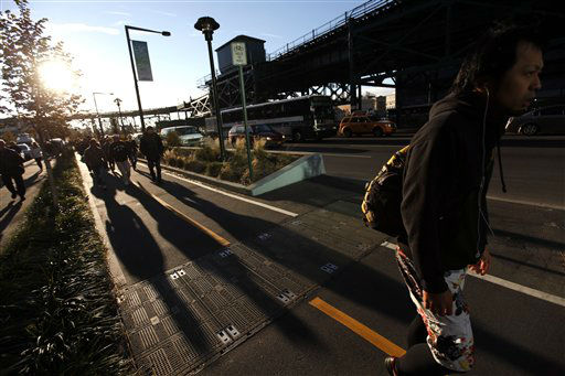 Commuters fill the pedestrian approach to the Queensboro Bridge as they make their way towards Manhattan during the morning rush, Thursday, Nov. 1, 2012, in the Queens borough of New York. &#40;AP Photo&#47;Jason DeCrow&#41; <span class=meta>(AP Photo&#47; Jason DeCrow)</span>
