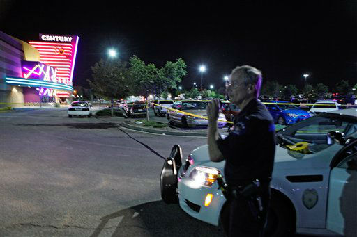 An Aurora Police officer talks on his radio outside of the Century 16 theater at Aurora Mall where as many as 14 people were killed and many injured at a shooting at the Century 16 movie theatre in Aurora, Colo., Friday, July 20, 2012. &#40;AP Photo&#47;Ed Andrieski&#41; <span class=meta>(AP Photo&#47; Ed Andrieski)</span>