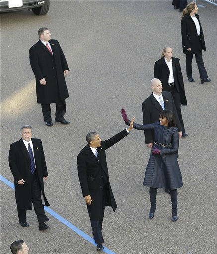 "<div class=""meta image-caption""><div class=""origin-logo origin-image ""><span></span></div><span class=""caption-text"">President Barack Obama and first lady Michelle Obama walk the inaugural parade route down Pennsylvania Avenue en route to the White House, Monday, Jan. 21, 2013, in Washington. Thousands  marched during the 57th Presidential Inauguration parade after the ceremonial swearing-in of President Barack Obama. (AP Photo/Charlie Neibergall) (AP Photo/ Charlie Neibergall)</span></div>"