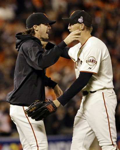 San Francisco Giants&#39; Barry Zito, left, and Hunter Pence celebrate after Game 1 of baseball&#39;s World Series against the Detroit Tigers Wednesday, Oct. 24, 2012, in San Francisco. The Giants won 8-3 to take a 1-0 lead in the series. &#40;AP Photo&#47;David J. Phillip&#41; <span class=meta>(AP Photo&#47; David J. Phillip)</span>