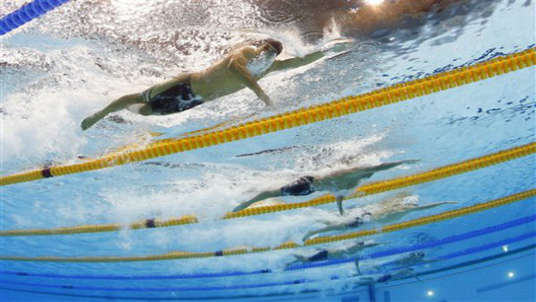 United States&#39; Ricky Berens, top, United States&#39; Ryan Lochte, center, and China&#39;s Sun Yang, top, compete in a men&#39;s 200-meter freestyle swimming heat at the Aquatics Centre in the Olympic Park during the 2012 Summer Olympics in London, Sunday, July 29, 2012. &#40;AP Photo&#47;David J. Phillip&#41; <span class=meta>(AP Photo&#47; David J. Phillip)</span>