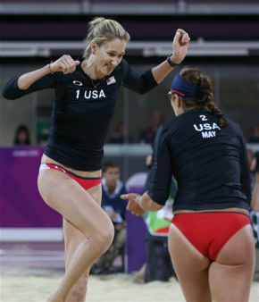 Misty May-Treanor, right, and Kerri Walsh, left, of US celebrate winning a point against Australia in their Beach Volleyball match at the 2012 Summer Olympics, Saturday, July 28, 2012, in London.